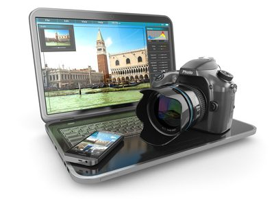Photo camera, laptop and mobile phone. Journalist  or  traveler equipment. 3d